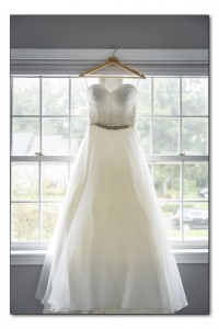 It was sweetheart neck, strapless, and flowy. It was opposite of what I wanted, but when I put it on I was emotional! I knew it was the one, everyone else had the same reaction. We added a belt to the dress to make it my own. We found it at In White in feeding hills.