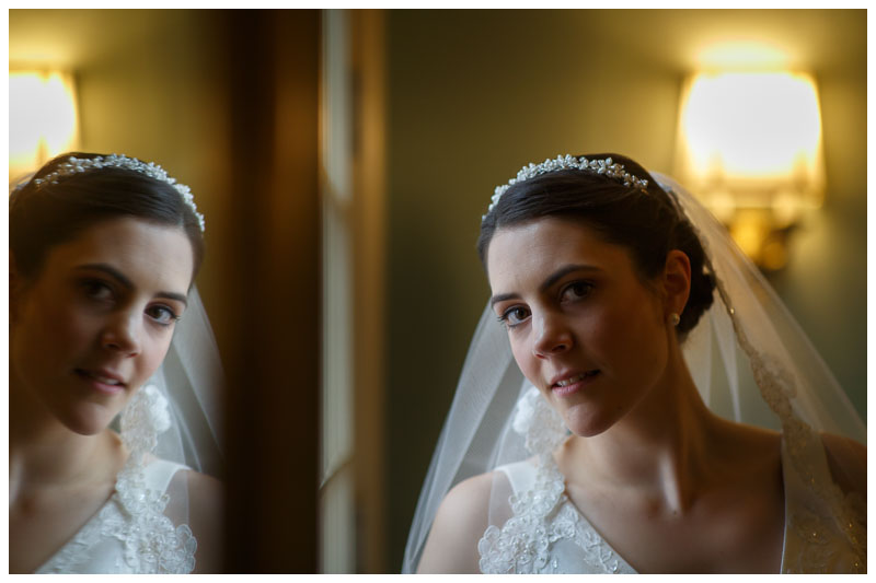 Bride portrait by fireplace and mirror at the Inn on Bol