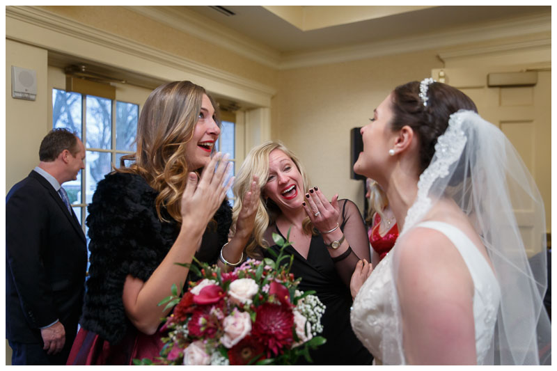 Bride with guests giving congratulations after ceremony