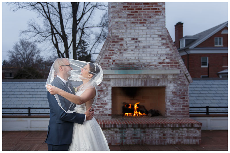 Bride and Groom portrait on the upper deck in front of the fireplace at the Inn on Boltwood