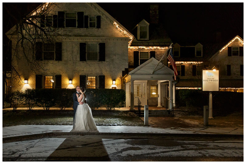 Dramatic bride and groom portrait in front of the Inn on Boltwood