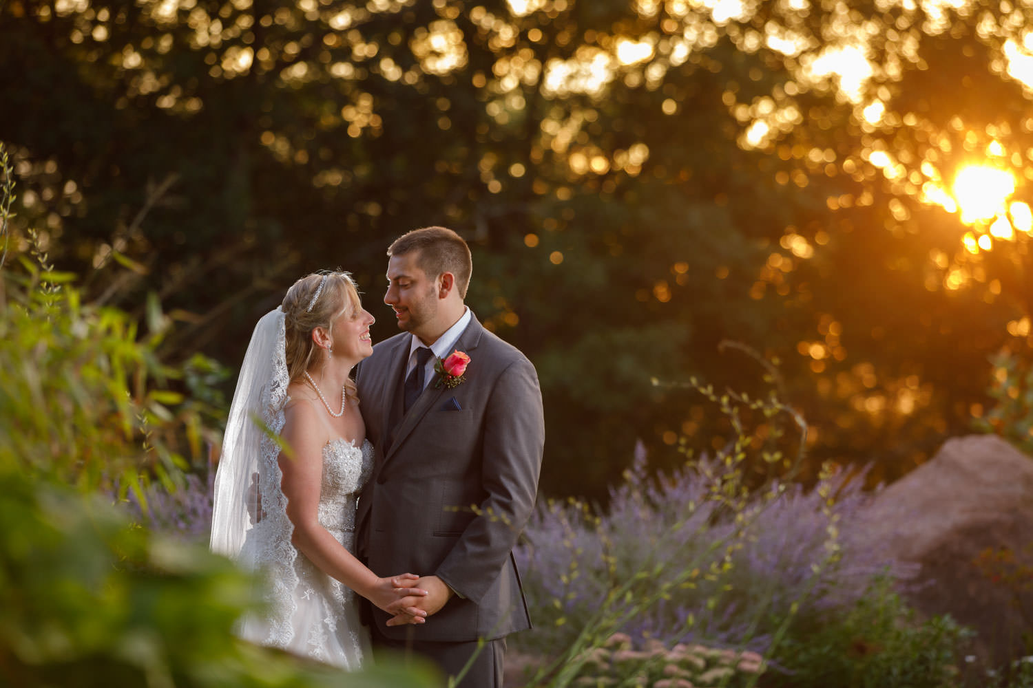 Sunset photo of Bride and Groom in garden