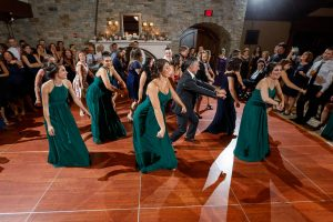 Bridesmaids doing special dance for wedding couple