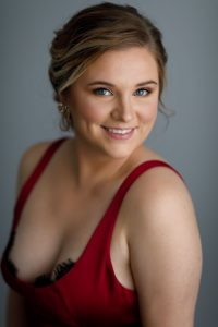 Bridesmaid natural light portrait with beautiful blue eyes