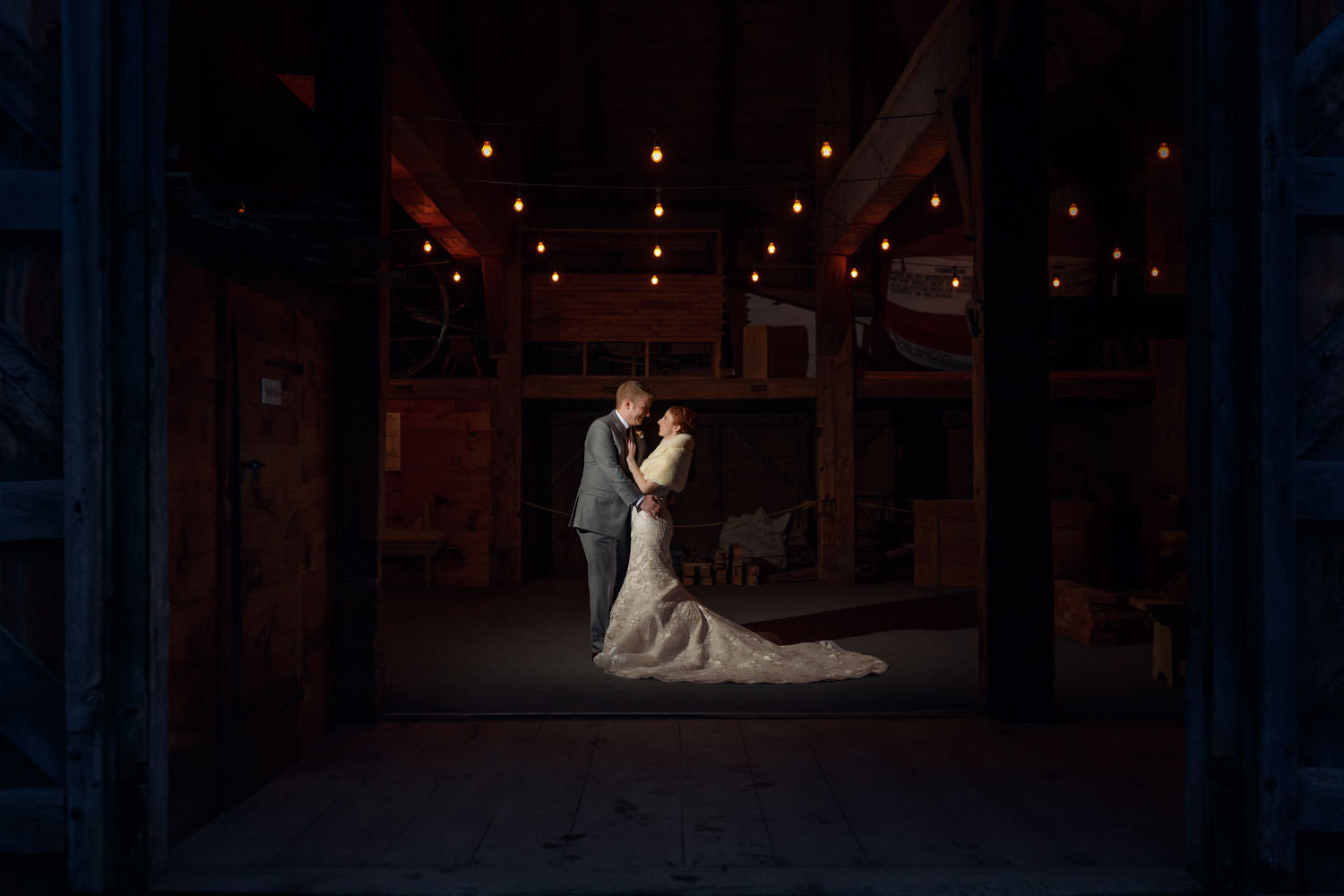 Bride and Groom at night in barn