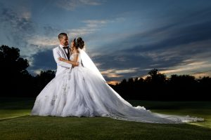 Bride and Groom sunset photo with bride in large white wedding dress