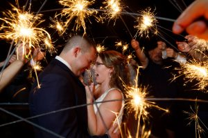 Bride and groom with sparklers all around them