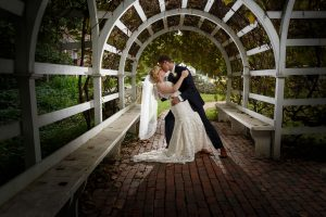 Groom dipping bride back light