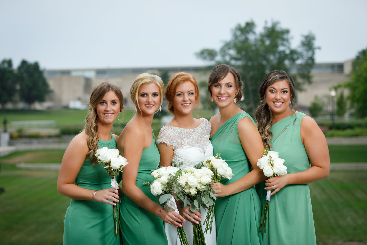 Bride and Bridesmaids on Umass Amherst Campus in background