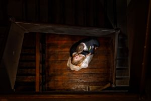 Bride and Groom at bottom of wooden stairwell