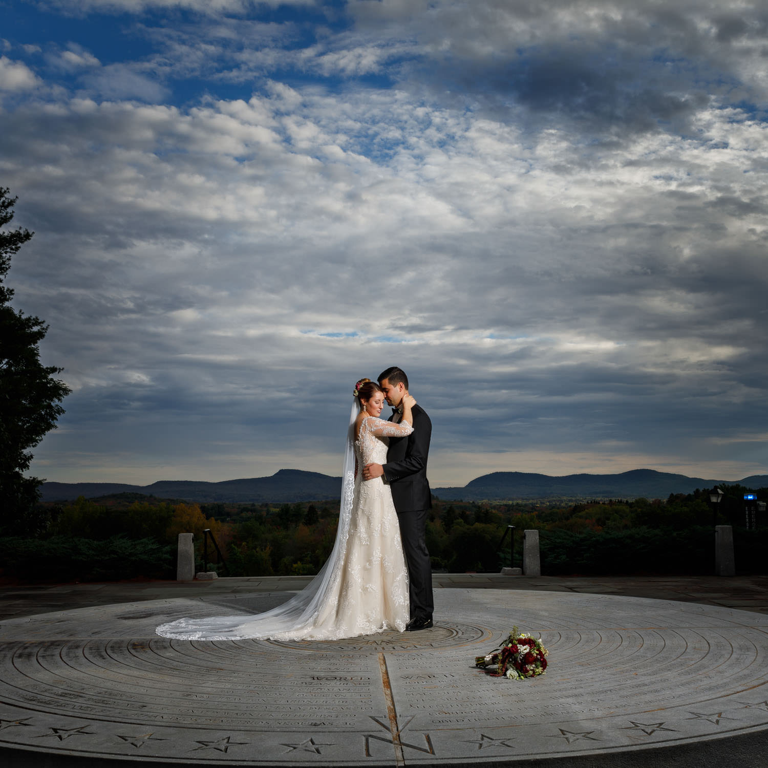Romantic bride and groom photo from Hampshire College with dramatic sky in the background