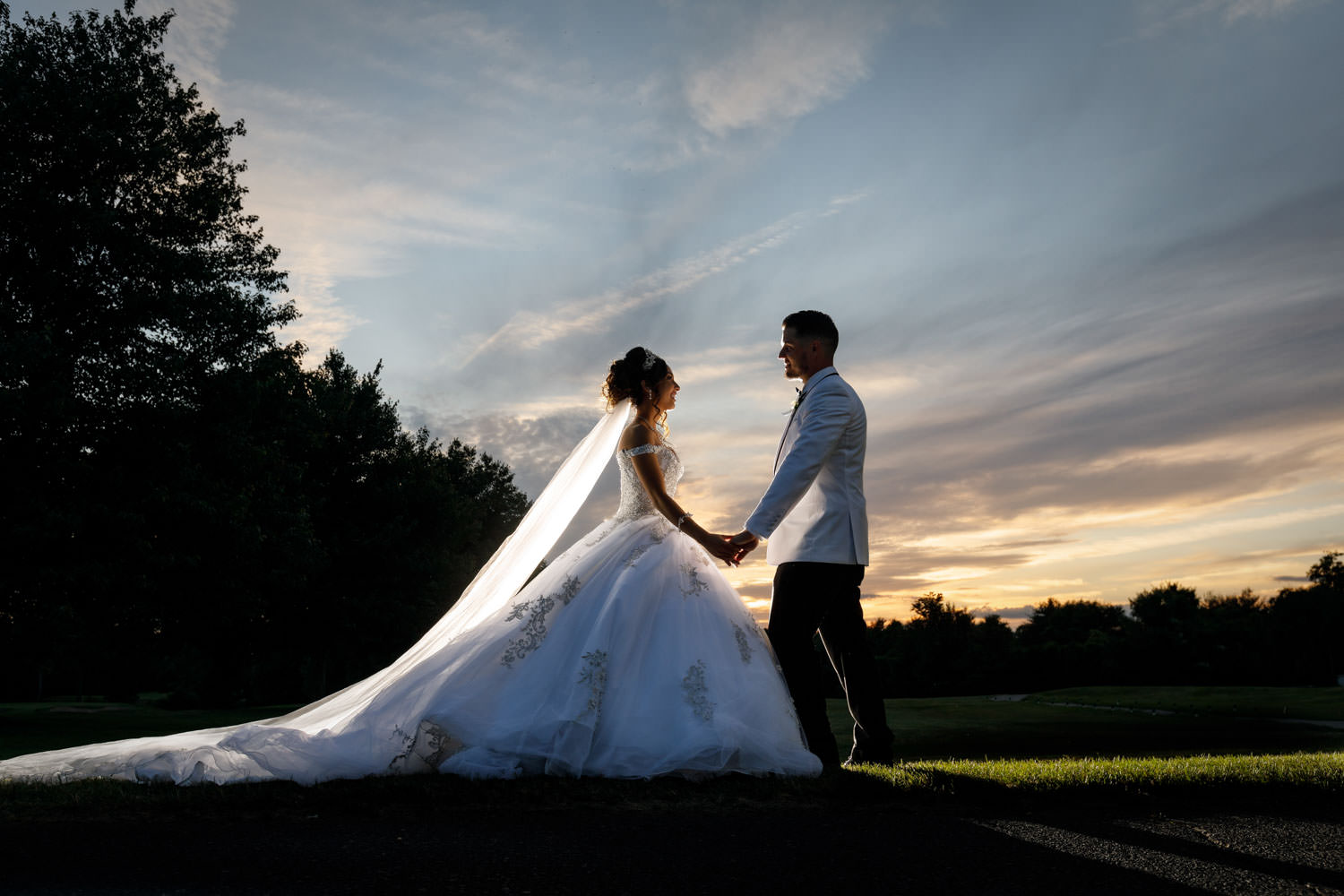 Bride and Groom sunset photo with dramatic sky in background