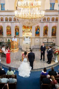 Bride and Groom during Greek ceremony at a stunning Greek church