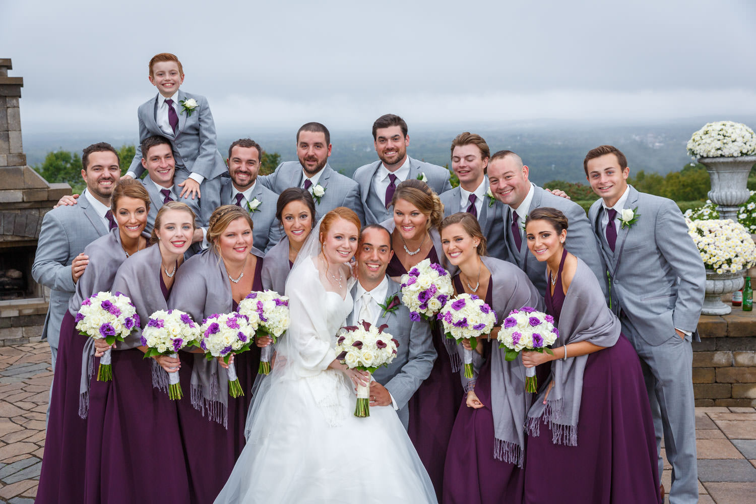 Large wedding party photo with flowers