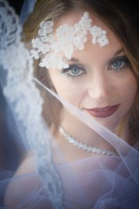 Bridal portrait with stunning eyes shot with wedding veil and lace