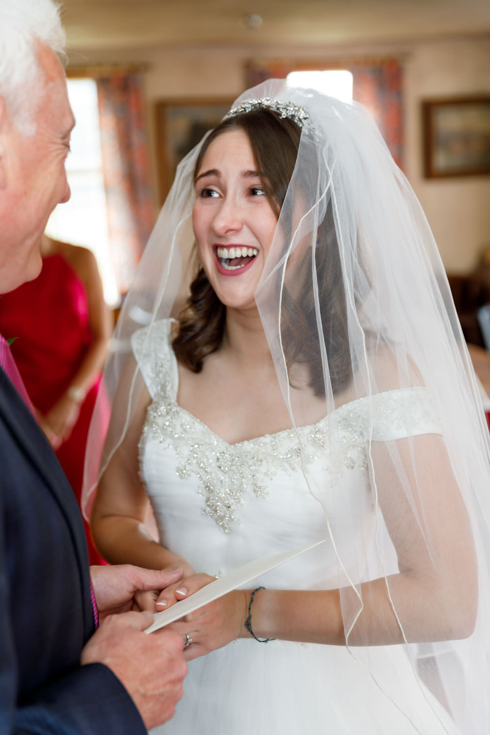 Bride and Father laughing together before wedding ceremony
