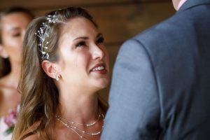 Bride with tears of joy during outdoor ceremony with simple head piece