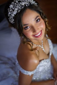 Beautiful Bride portrait on wedding day with sparkling dress.
