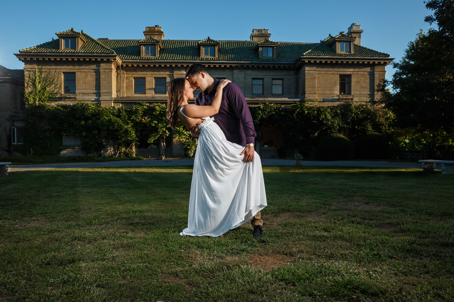 engaged couple in front of mansion at Harkness State Park