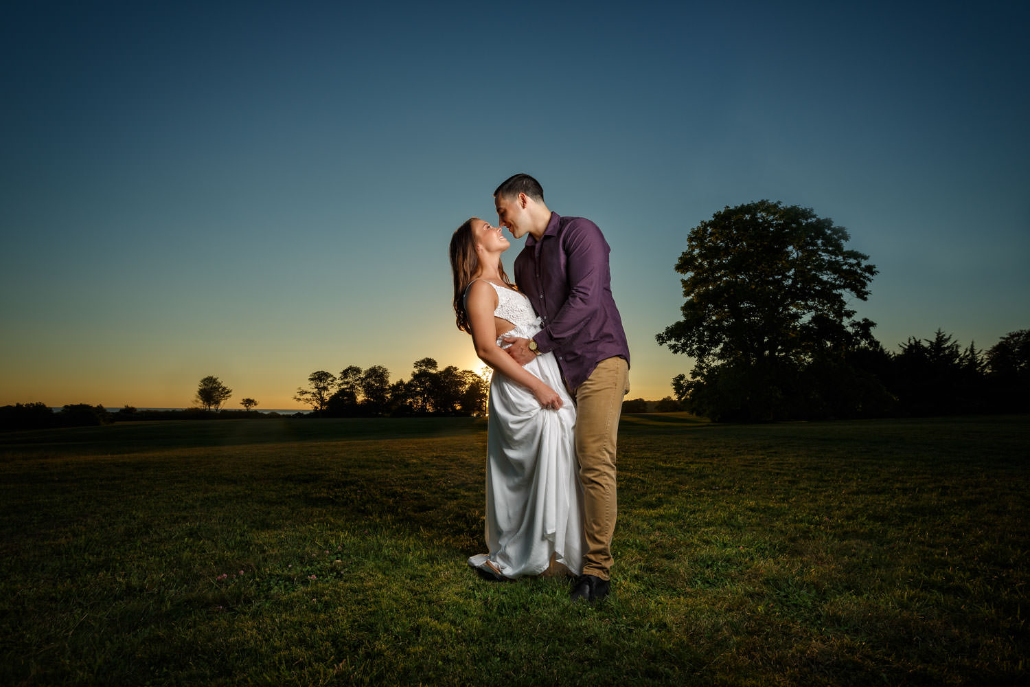 Gorgeous couple at sunset at Harkness State park