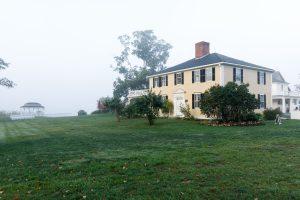 Foggy morning photo of the outside of the Salem Cross Inn.