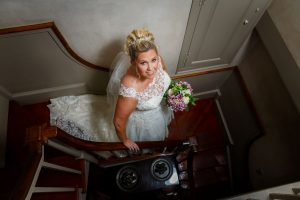 Bride walking down stairs on her way to the ceremony