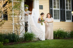 Bride and mother walking out of the Salem Cross Inn to the outdoor ceremony