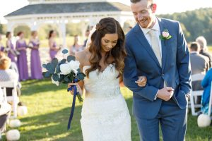 Bride and groom smiling during their recessional.