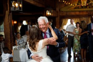 Father Daughter dance with smiling father
