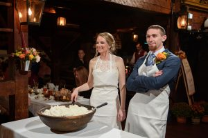 Bride and Groom Dishing out Whipped cream from huge bowl for the apple pie