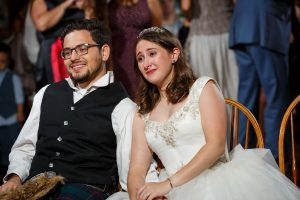 Emotional Bride and Groom viewing their same day slideshow
