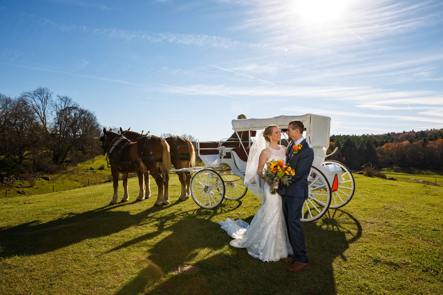 Bride and groom in front of horse drawn carriage at the Salem Cross Inn