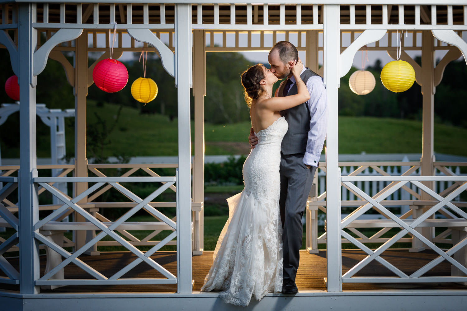 Couple Kissing at Salem Cross Inn Gazebo decorated with Chinese lantern