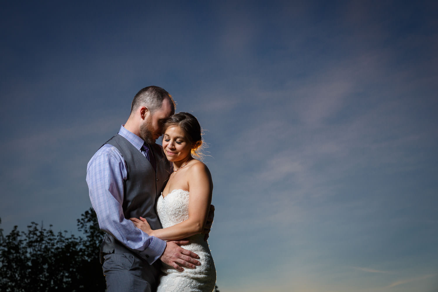Bride and Groom portrait featuring bride at sunset