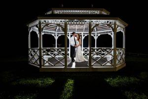 Bride and Groom portrait at night inside gazebo