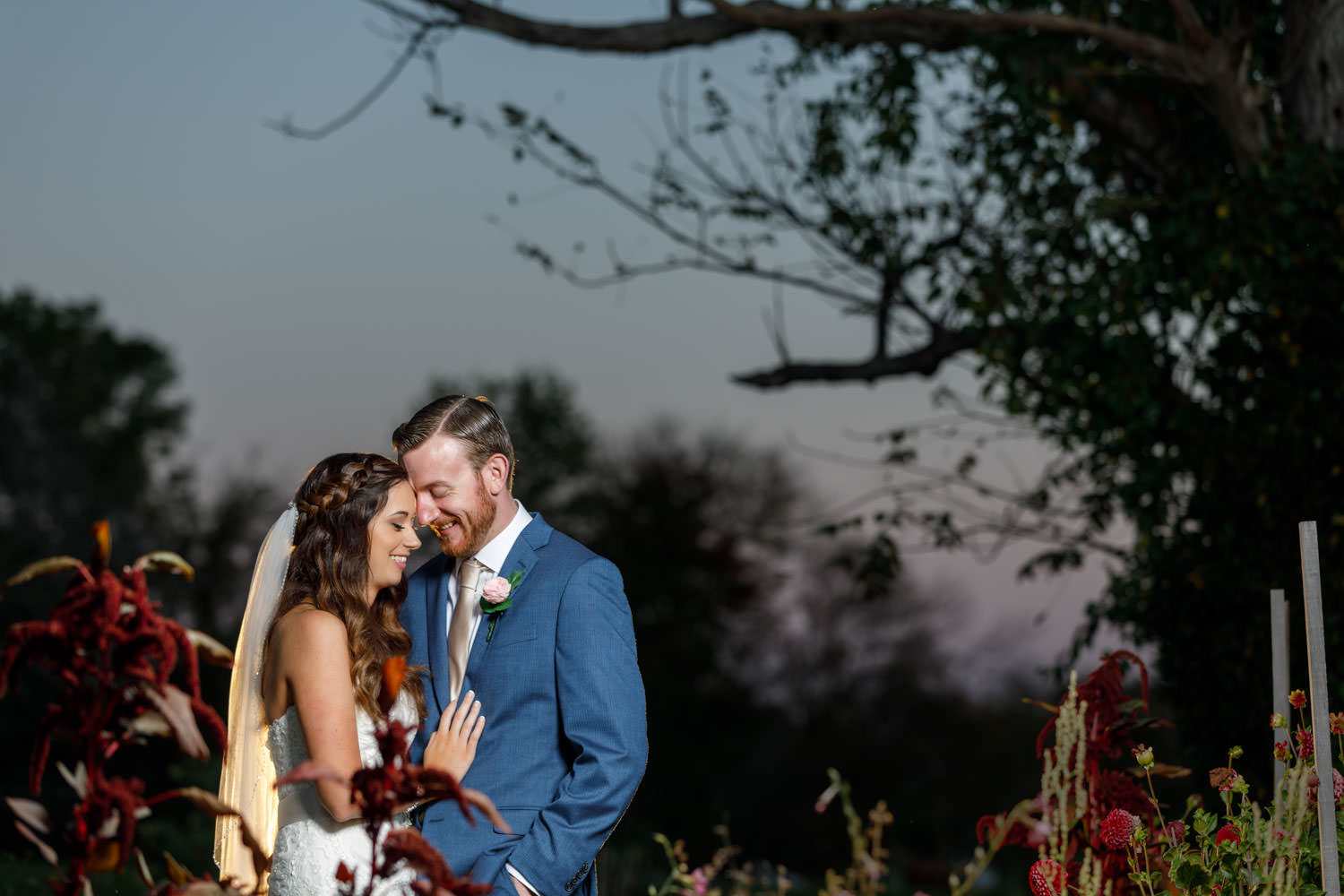 Bride and Groom Portrait at sunset in garden