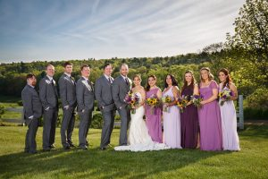 Wedding party photo, outside with rolling hills in the background