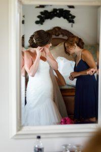 Bride putting jewelry on