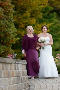 Bride and Mom walking down the aisle