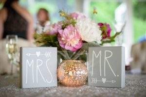 Mr and Mrs sign and wedding flowers