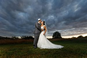 Sunset photo of jewish bride and groom wearing yamaka