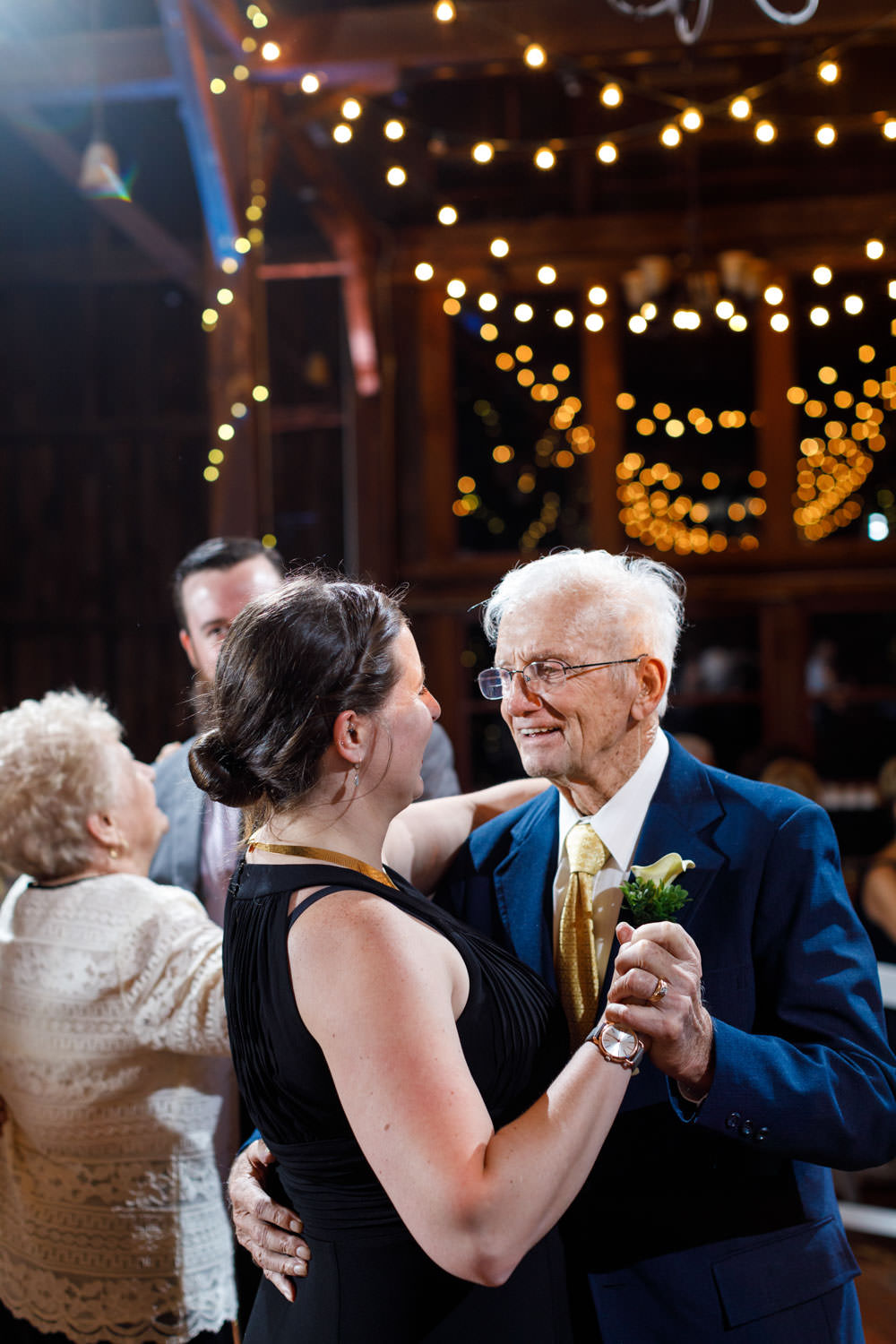 Grandpa of the bride dancing with guest at receptions