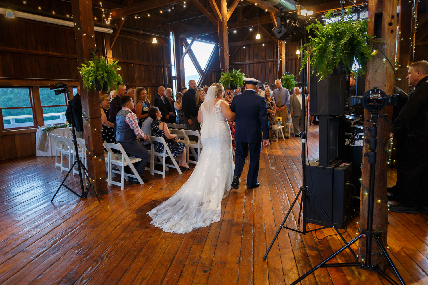 Bride during recessional with father during indoor ceremony
