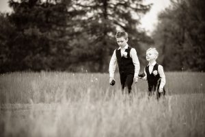 Black and White photo of ring bearers walking down the aisle