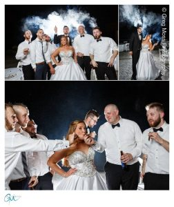 Bride and Groom and groomsmen smoking cigars at night outside.