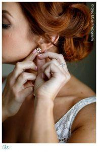 Bride putting earirng in.