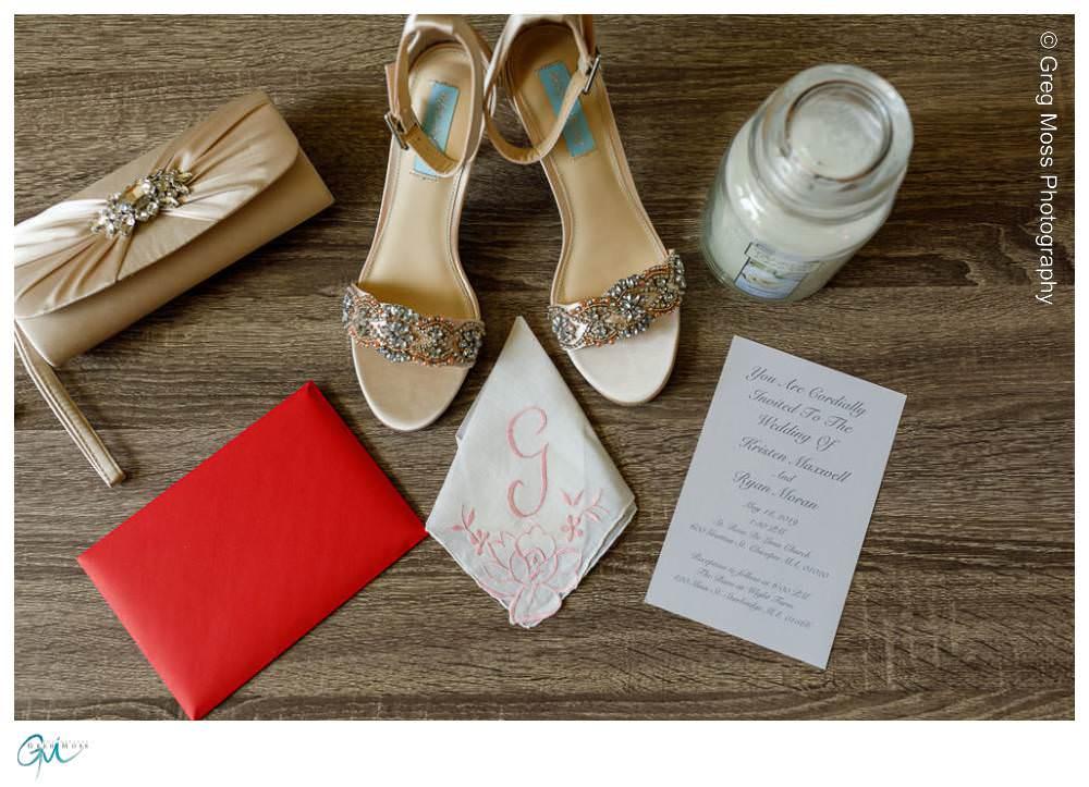 Brides details, shoes, invitation, earrings, handbag