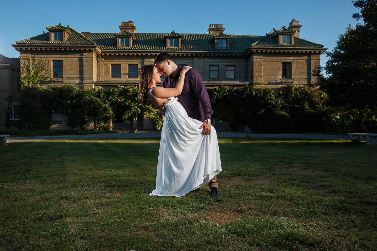 Engaged couple with a little dip in front of main building