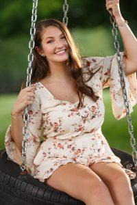 High school girl on tire swing