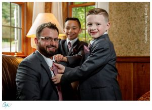 Groom getting ready for wedding with sons